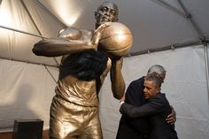 President Barack Obama is greeted by Bill Russell during a stop to view the statue of Russell at City Hall Plaza in Boston, Mass., Oct. 30, 2013.