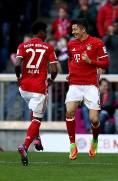 Robert Lewandowski (R) of Muenchen celebrate with team mate David Alaba after he scores the 3rd goal during the Bundesliga match between Bayern Muenchen and Hamburger SV at Allianz Arena on February 25, 2017 in Munich, Germany.