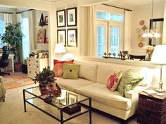 Nice looking the open wall space between dining room and living room. The low couch looks great there.