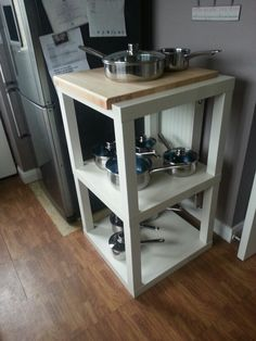 Made with three ikea lack table screwed and glued together finished with chopping board from ikea! Kitchen island! !