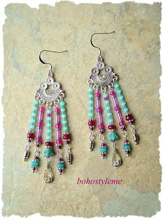 Created with gemstones, and Czech glass, these stunning chandelier earrings are alive with bohemian colors. The five strands dangle freely from wonderful boho style components, studded with Swarovski crystals. Each strand is finished with its own unique dangle, including vintage silver