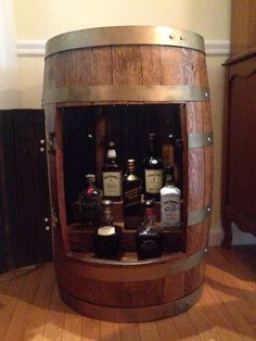 Superbe Whiskey Barrel Cabinet Filled With Jack And Johnny.