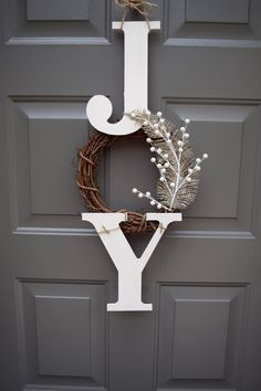 JOY Sign ***With small green wreath form wrapped in red