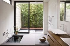 A sunken bath tub takes the minimalistic zen look a step further. | Architect: Aidlin Darling Design
