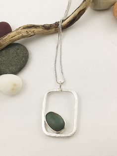 If you love #naturaljewelry, this striking pebble pendant with #sterlingsilver bezel setting is guaranteed to please you. It is handcrafted using artist found pebbles from Washington state's Puget Sound beaches. This pebble is set in a hand forged sterling setting which is hammered to catch the light. This pendant comes on a sterling silver chain. It will become your favorite necklace that is noticed by all your friends for its uniqueness.