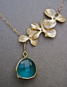 something blue--- beach wedding in hawaii (Bezel Set Ocean Blue Glass and Gold Orchid Flower Lariat Necklace in 14K Gold. $39.00, via Etsy.)