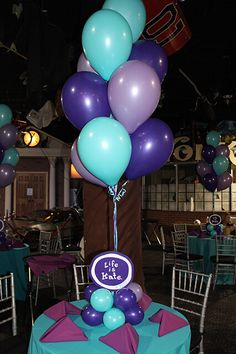 Purple & Turquoise Balloon Centerpieces with Cutout Logos in Balloon Bases Purple Princess Party, Purple Party, Balloon Centerpieces, Balloon Decorations, Reception Decorations, Ballons Violets, Balloon Inside Balloon, Turquoise Baby Showers, Balloon Clusters