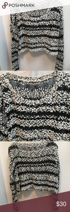 "Rehab Black And White Sweater 60% polyester. 40% acrylic.  Perfect condition  length is about 16""  across laying flat is 16""  the sleeves are about 21"" Rehab Sweaters"