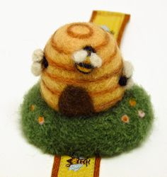 Felted beehive pincushion