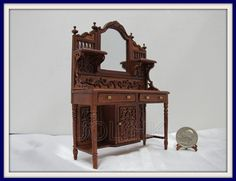 "1"" Scale Doll House Wood Carved Sideboard Finished In Walnut by UOLHKscalefurniture on Etsy https://www.etsy.com/listing/197612591/1-scale-doll-house-wood-carved-sideboard"