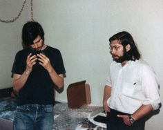 Steve Jobs looks at the blue box with Steve Wozniak