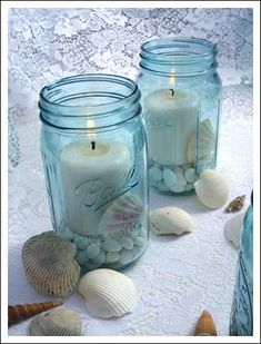 Blue Mason Jars and Beach Wedding Centerpieces...I would have shells in the bottom and a coral flower on top