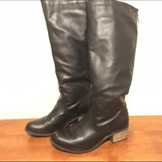 """Vegan Leather Knee High Boots Very stylish black vegan leather boots with a stacked 1 inch heel. Only worn a few times, minor scuff on toe as seen in photo (will try to remove it before I send them). These are your average height knee high boots and hit about 2 inches below my knee (I'm 5'2""""). There is a zipper running down the back to make putting them on and taking them off easy. They are a fall/winter staple and can be dressed down with tall socks and jeans or made super chic with an all…"""
