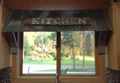 Metal awning over the kitchen sink Window Over Sink, Kitchen Sink Window, Kitchen Decor, Kitchen Design, Kitchen Ideas, Metal Awning, Fabric Awning, Kitchen Window Treatments, Window Awnings