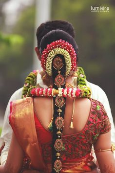 South Indian bride. Gold Indian bridal jewelry.Temple jewelry. Jhumkis. Red and…