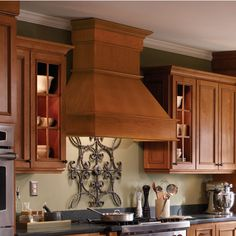 $700-$1000 The Signature Series range hoods by Omega National is available in 36 inch , 42 inch , and 48 inch widths and measures 22-7/8 inch High. The range hood is available in five different wood types including Red Oak, Maple, Alder, Hickory, and Cherry. Also available with a 23-1/2 inch or 31 inch tall chimney which can be trimmed to fit ceilings of any height. Includes a Biscuit colored liner.