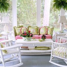 beautiful sunroom, so light and airy. our favorite and classic white wicker with pink and floral cushions and pillows is lovely. the perfect addition to a victorian home