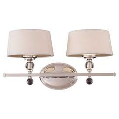 "Add a touch of elegance to your powder room or master bath with this chic vanity light, showcasing a polished nickel finish and clear orb accents.    Product: Vanity lightConstruction Material: Metal and fabricColor: Polished nickel and whiteFeatures: Orb accentsAccommodates: (2) 40 Watt G9 bulbs - not includedDimensions: 9"" H x 18"" W x 9"" D"