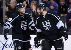 LOS ANGELES, CA - MAY 17: (L-R) Jarret Stoll #28 and Dwight King #74 of the Los Angeles Kings celebrate after Kings third period goal against the Phoenix Coyotes in Game Three of the Western Conference Final during the 2012 NHL Stanley Cup Playoffs at Staples Center on May 17, 2012 in Los Angeles, California. (Photo by Harry How/Getty Images)