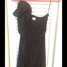Black long formal/ball/pageant dress Great detailing on the shoulder and flows all the way down to the bottom seam. Second picture shows the full length. Third picture shows the detail on the bottom. There is grip material on the inner lining of the bust to help it stay up. Excellent used condition. Smoke free home. UK size 8., so US size 4. Oasis Dresses