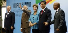 This photo shows Puting with the BRICS. They made a little bank to loan money to people whom the IMF won't lend to. It is interesting to note the distance Putin keeps from the 4 in the photo. This is a visual clue that he secretly is weary of Brazil, India, China and South Africa. Those 4 still are die hard fans of the Americans. The Chinese never forgave the Russia for what they did to them during the Cold War.