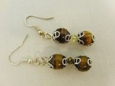 Tigers Eye Bead with a Yellow Crystal Bicone by OswestryJewels