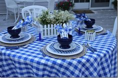 """Tablescape - note """"picket fence"""" around napkins and candles - can be found at craft stores"""