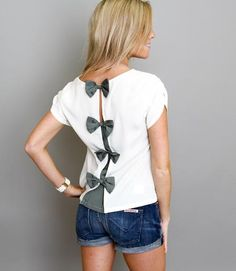 Bow back closure. Easy to do with a plain white t-shirt. Would be cute on the girls for summer.