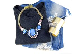 Bold accessories are the perfect way to spice up a simple jeans and a tee shirt outfit! Shop Now! www.5thandMarket.com