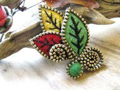 Zipper and felt leaf brooch by woolly  fabulous, via Flickr