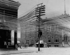 vintage everyday: View of a lineman working on power or telephone lines at an intersection in Pratt, Kansas, 1911