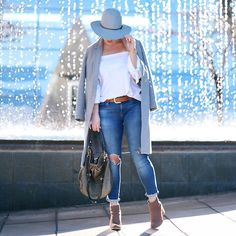 Get this look: http://lb.nu/look/8588977  More looks by Alexandra G.: http://lb.nu/tovogueorbust  Items in this look:  Aritzia Off The Shoulder Top, Mavi Ripped Skinny Jeans, Marc Jacobs Hobo Bag   #casual #chic #classic #layers #offtheshoulder #denim
