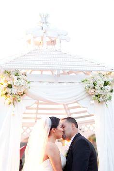 White and blush ceremony decor.
