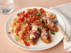 Start a family tradition: Italian night! Make Rachael's juicy breaded chicken tenders and serve alongside simple, fresh marinara sauce and spaghetti.
