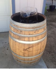 Wine Barrel Fountain with flower water feature via Etsy