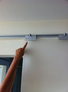 Materials: Besta Rails, Shower Clamps, Ikea cabinet handle, Plexiglas sheets Description: Removed all conventional doors in my house. I hung 70″ BESTA rails ($25)over the door openings. I then used shower door clamps ($6.each) to slide into the Besta railing. I had my local plastics company cut me a 1/2 inch sheet of frosted Plexiglas [&hellip