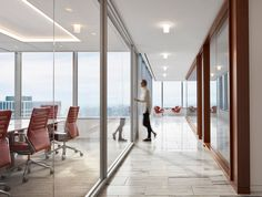 Located on the 36th floor, the Angelo Gordon's Twin Brooks Capital Partners collaboration-focused office has some of the best views of Chicago! The views are accentuated by Architect Stephen Yablon's use of glass partitions, award-winning lighting, and walnut SoundPly Latus Acoustic Wall Panels. #OfficeDesign #SoundPly #Chicago Wood Ceiling Panels, Wood Ceilings, Acoustic Wall Panels, Glass Partition, Showcase Design, Nice View, Plank, Collaboration