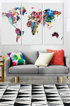 Love the colors of the three-panel map of the world.... perfect for a black/white room with bright accents.