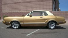 In honor of the 50th anniversary of the Ford Mustang ~ One of my favorite cars I ever owned was like this Medium Gold 1976 Mustang II MPG.