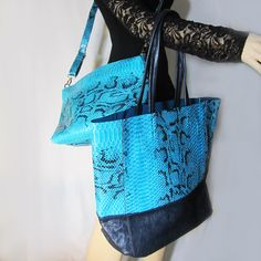 Elegant blue and black faux python tote bag with cross body bag in a bag designed by Liz Soto. Perfect for your Casual or Stay In Date (you can fit all you need in those two bags). Excellent quality. Makes a great gift. #handbags, #purses, #totes, #accessories, #fashion, #elegant, #women, #beautiful, #designer, #bags