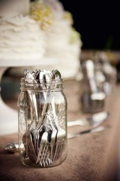 Mason Jar For Silverware At Wedding, maybe decorated with wedding colors...with all the silverware our families have, this could be a cute cost saver and give it a little bit of class...each table could have different sets of plates that belong to us by lea