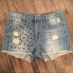Forever 21 Studded High Waisted Shorts! Size 29 Studded high waisted shorts from Forever 21! I bought the wrong size at the store and don't have a store near me to return them, so I'm bummed I have to sell these because they are super cute! I have never worn them before. Studs are on the front and back of the right side. In brand new condition! Forever 21 Jeans
