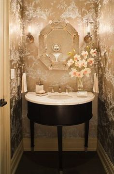 The Chinoiserie Chic Powder Room ~ beautiful glazed wall paper shimmers under the lights.  Very feminine.