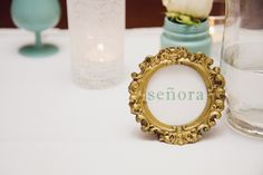 gold framed wedding name cards