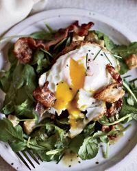 "Warm Bacon-and-Egg Salad -""I like a fried egg,"" says April Bloomfield about the topping on her arugula salad. ""Especially when it's fried in bacon fat."" She likes to use rich duck eggs when she has them.  (from Food & Wine)"