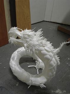 Design idea for a Teen Advisory Board, perhaps a collaborative plastic utensil animal program to make sculptures for in the library. Look closely and you'll see what this plastic dragon sculpture is actually made of: disposable spoons, knives, forks and cups. It took toge at DeviantArt approximately 80 hours - more hours than dollars - to create this work of art.