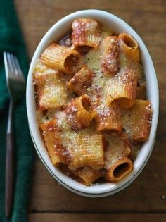 This is literally the easiest meal on the face of the earth -- Cheesy Baked Rigatoni Recipe http://thestir.cafemom.com/food_party/165959/cheesy_baked_rigatoni_recipe_takes?utm_medium=sm&utm_source=pinterest&utm_content=thestir