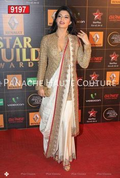 Jacqueline Fernandez went desi in an Anand Kabra sari which she wore wih a long golden blouse at the Star Guild Awards