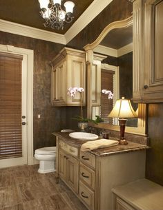 The cream glazed cabinetry in this elegant bath.