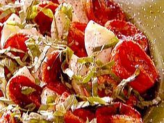 Ina's Roasted Tomato Caprese Salad...halfway between a regular tomato and a sundried one.  I could eat this as a meal.